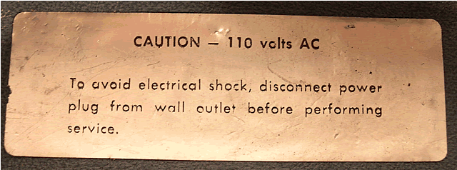 Warning inside the power cable storage.