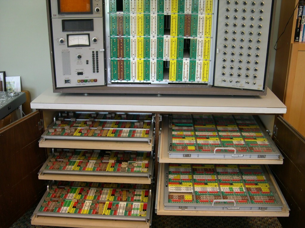 image of TR48 sits on customized desk w/ patchboard shelves